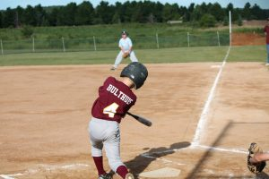 little league baseball player up to bat